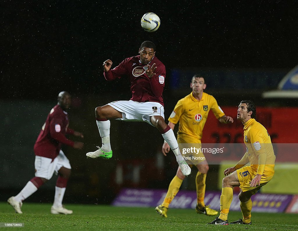 Clive Platt of Northampton Town rises to head the ball during the npower League Two match between Oxford United and Northampton Town at Kassam Stadium on November 24, 2012 in Oxford, England.
