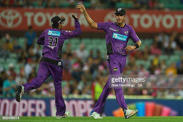 Clive Rose of the Hurricanes celebrates with Stuart Broad of the Hurricanes after taking a catch to dismiss Brad Haddin of the Sixers during the Big...
