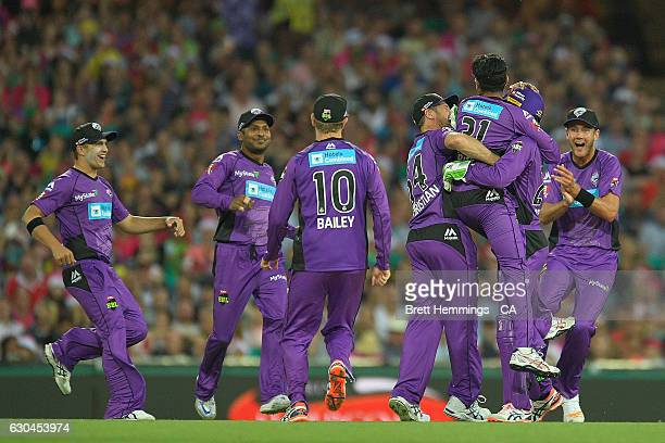 Clive Rose of the Hurricanes celebrates with team mates after taking the wicket of Moises Henriques of the Sixers during the Big Bash League match...