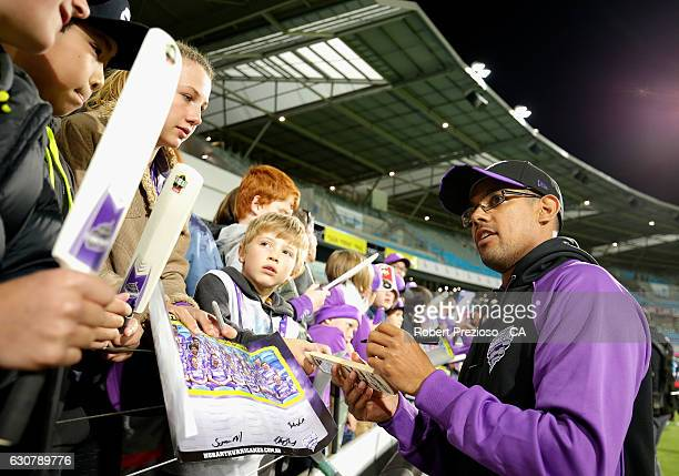 Clive Rose of the Hurricanes signs autographs during the Big Bash League match between the Hobart Hurricanes and Adelaide Strikers at Blundstone...
