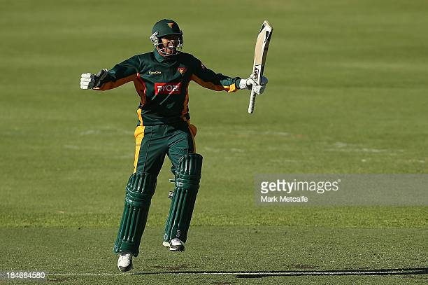 Clive Rose of the Tigers celebrates hitting the winning runs during the Ryobi Cup match the Queensland Bulls and the Tasmania Tigers at Hurstville...