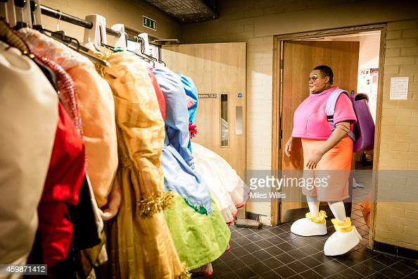 Clive Rowe playing Mother Goose leaves his dressing room during a performance of Mother Goose at Hackney Empire on December 2 2014 in London England