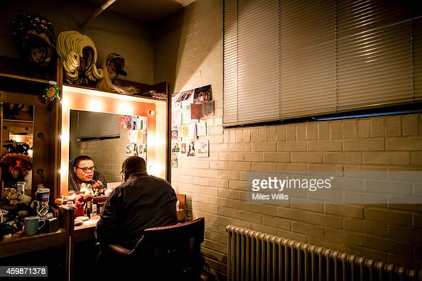 Clive Rowe playing Mother Goose prepares in his dressing room prior to a performance of Mother Goose at Hackney Empire on December 2 2014 in London...