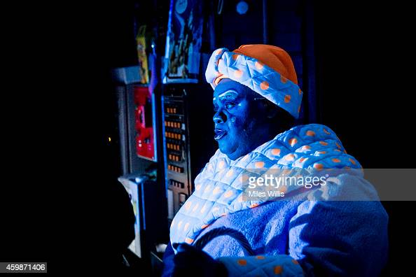 Clive Rowe playing Mother Goose waits stage right during a performance of Mother Goose at Hackney Empire on December 2 2014 in London England