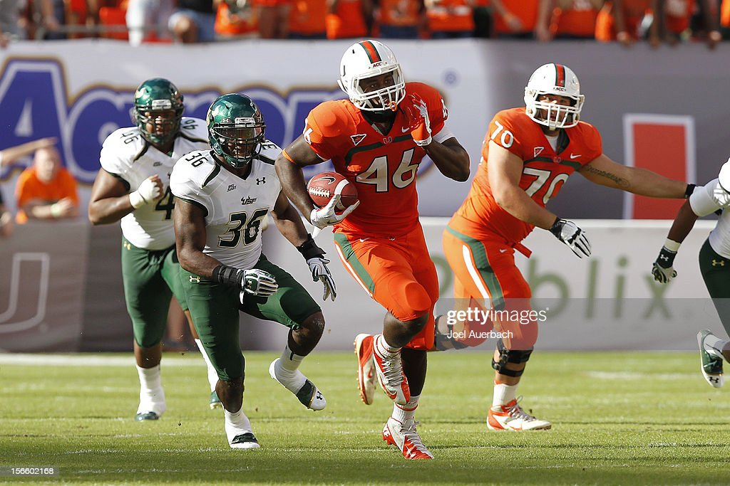 Clive Walford #46 of the Miami Hurricanes runs with the ball against the South Florida Bulls on November 17, 2012 at Sun Life Stadium in Miami Gardens, Florida. The Hurricanes defeated the Bulls 40-9.