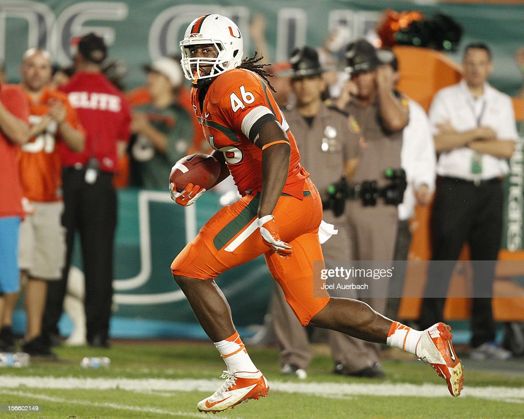 Clive Walford #46 of the Miami Hurricanes runs with the ball for a touchdown against the South Florida Bulls on November 17, 2012 at Sun Life Stadium in Miami Gardens, Florida. The Hurricanes defeated the Bulls 40-9.
