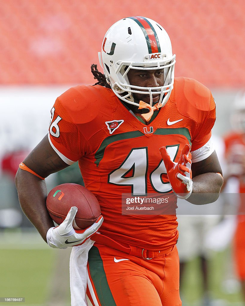 Clive Walford #46 of the Miami Hurricanes runs with the ball prior to the game against the South Florida Bulls on November 17, 2012 at Sun Life Stadium in Miami Gardens, Florida. The Hurricanes defeated the Bulls 40-9.