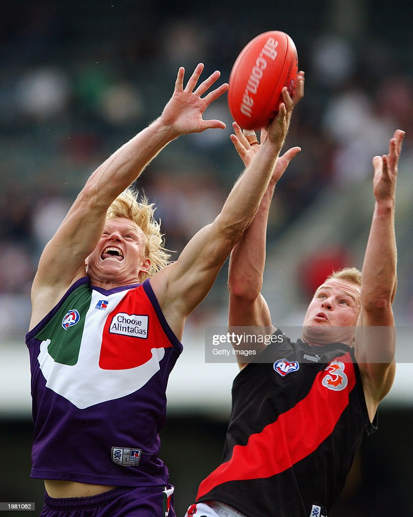Clive Waterhouse of the Dockers takes a mark whilst under pressure from Sean Wellman of the Bombers during the round six AFL match between the...