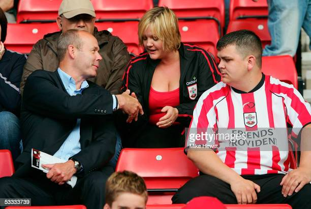 Clive Woodward introduces himself to a Southampton fan during the CocaCola Championship match between Southampton and Wolverhampton Wanderers at the...