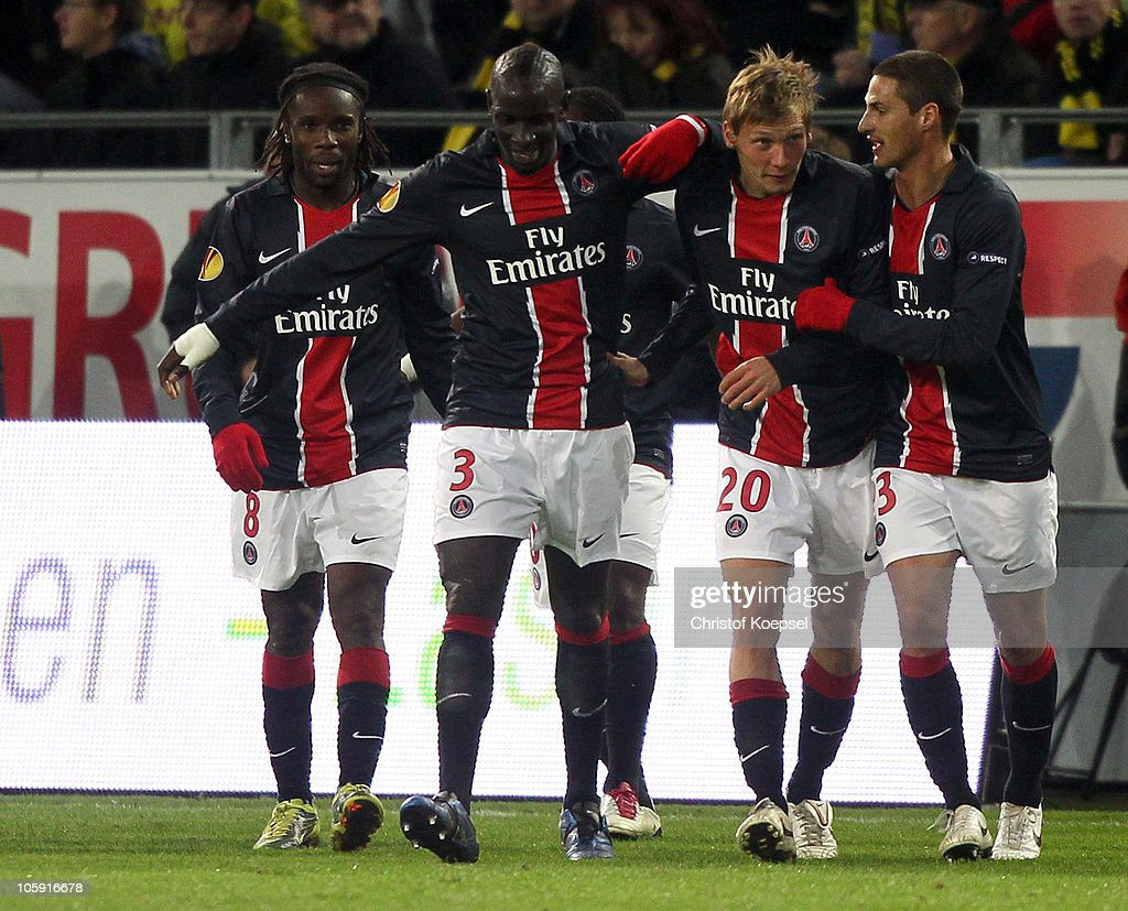 Clément Chantome of Paris (2nd R) celebrates the first goal with <a gi-track='captionPersonalityLinkClicked' href=/galleries/search?phrase=P%C3%A9guy+Luyindula&family=editorial&specificpeople=769993 ng-click='$event.stopPropagation()'>Péguy Luyindula</a> (L), Mamadou Sakho (2nd L) and <a gi-track='captionPersonalityLinkClicked' href=/galleries/search?phrase=J%C3%A9r%C3%A9my+Cl%C3%A9ment&family=editorial&specificpeople=648908 ng-click='$event.stopPropagation()'>Jérémy Clément</a> of Paris (R) during the UEFA Europa League group J match between Borussia Dortmund and Paris Saint Germain at Signal Iduna Park on October 21, 2010 in Dortmund, Germany.