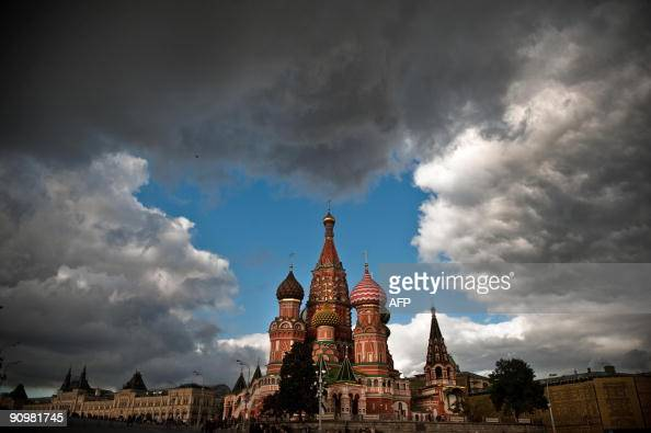 Cloads float over Saint Basil's Cathedral in Moscow on September 20 2009 AFP PHOTO/ DMITRY KOSTYUKOV
