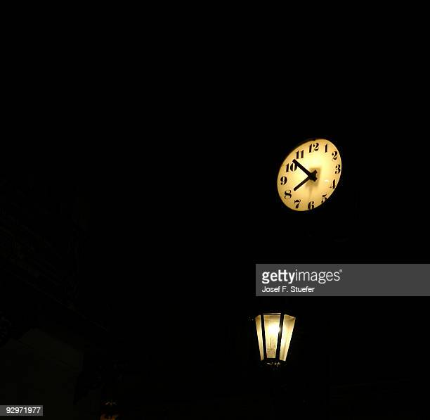 Clock and Lamp at night