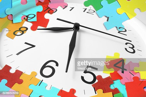 Clock and Puzzles : Stock Photo