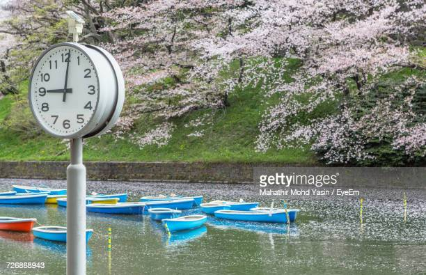 Clock By Boats Moored In Lake At Chidori-Ga-Fuchi