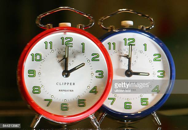 clock change alarm clocks are showing 2 o'clock and 3 o'clock