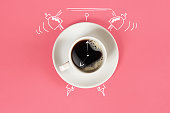 Clock. Cup of fresh espresso with clock sign on pink background. Still life. Mock up. Flat lay. Copy space