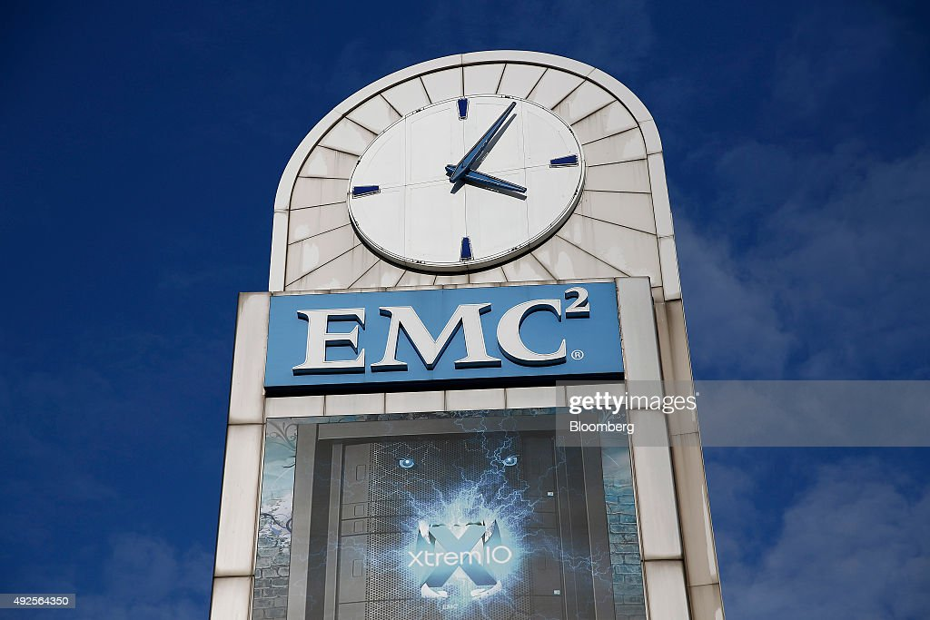 A Clock Face Sits On Top Of EMC Corp. Signage Advertising XtremIO All Flash