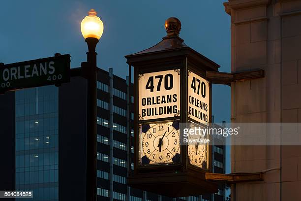 Clock hanging on the facade of the 1925 American National Bank Building in downtown Beaumont Texas