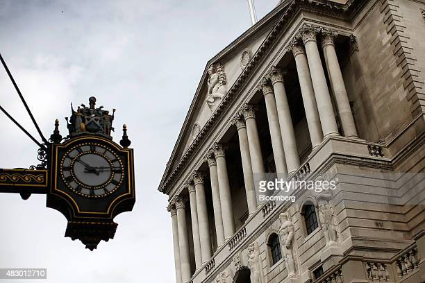 A clock hangs on the wall of the Royal Exchange opposite the Bank of England in the City of London UK on Wednesday Aug 5 2015 The pound strengthened...