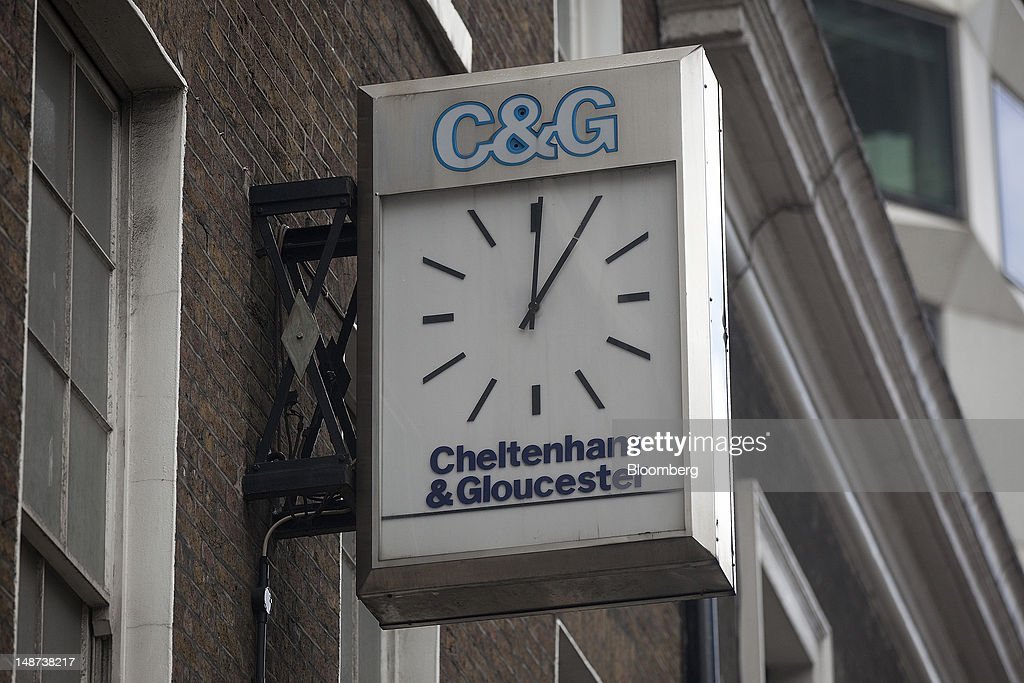 A clock hangs outside a Cheltenham & Gloucester bank branch, part of the Lloyds Banking Group Plc, in London, U.K., on Thursday, July 19, 2012. Lloyds Banking Group Plc agreed to sell 632 branches to Co-Operative Bank Plc for an initial 350 million pounds ($548 million), as the U.K.'s biggest mortgage lender divests assets to comply with its government bailout. Photographer: Simon Dawson/Bloomberg via Getty Images