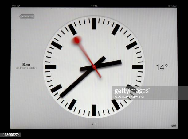 A clock is pictured on a Apple's Ipad model on October 12 2012 in Lausanne Swiss Federal Railways train operator said it have concluded a licensing...