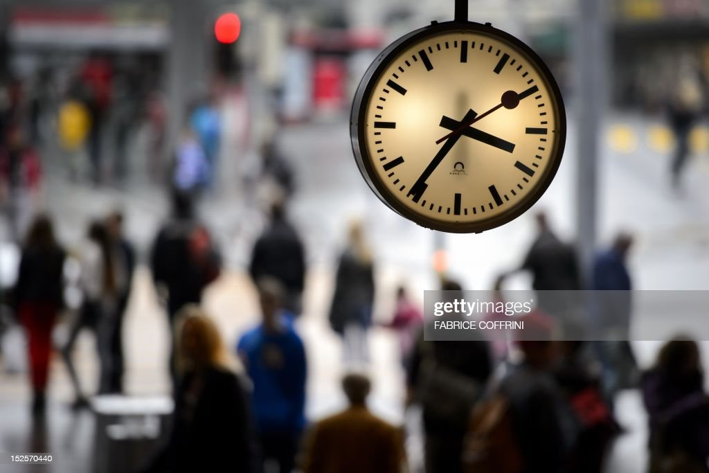 A clock of the Swiss national train operator SBB is seen on September 22, 2012 at the railway station in Bern. Train operator SBB said it is to meet Apple representatives after the tech giant used without agreement its famous clock design on one of its new apps iOS 6. AFP PHOTO / FABRICE COFFRINI