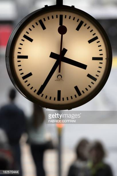 A clock of the Swiss national train operator SBB is seen on September 22 2012 at the railway station in Bern Train operator SBB said it is to meet...