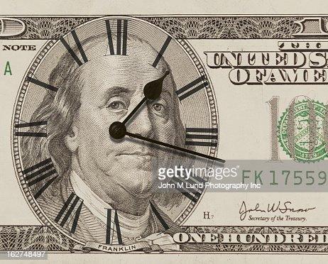Clock on one hundred dollar bill