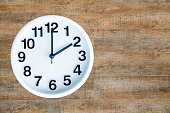 Clock show 2 am or pm on wood background with copy space. clipping path in picture.