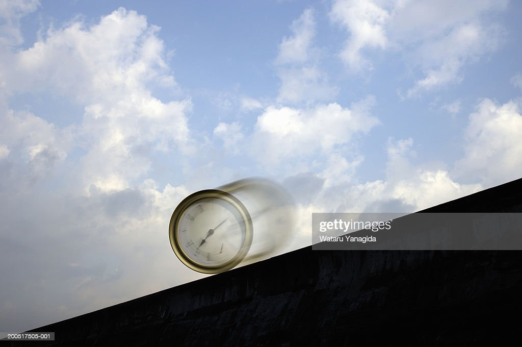 Clock rolling down slope (Digital Composite) : Stock Photo