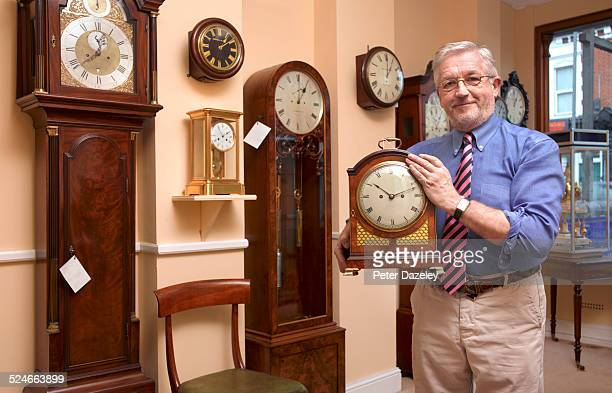 Clock shop owner/manager
