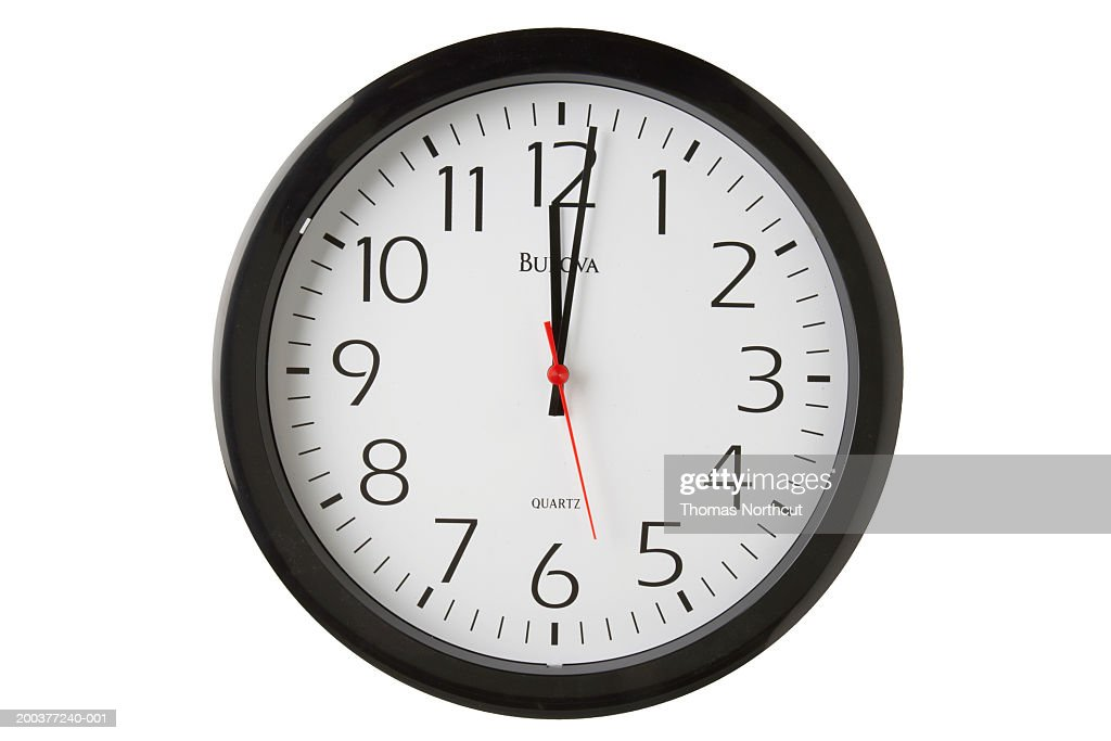 Clock showing one minute past 12 o'clock : Stock Photo