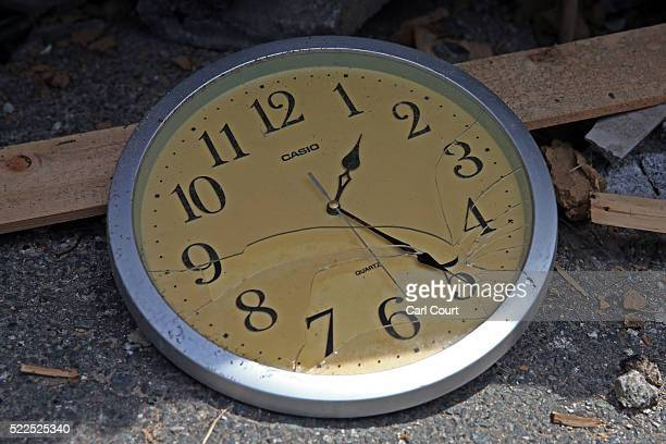 A clock showing the exact time that the earthquake struck lies on the ground following an earthquake on April 20 2016 in Mashiki near Kumamoto Japan...