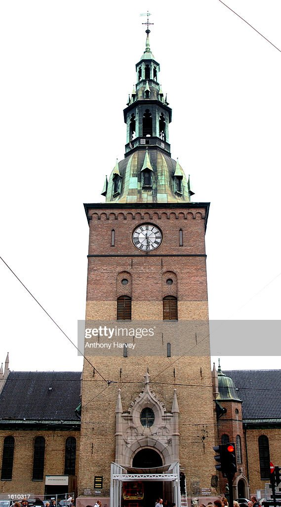 A clock shows the time on the tower of the Oslo Cathedral August 23 2001 in Oslo Norway where HRH Crown Prince Hakon and MetteMarit Tjessem Hoiby...