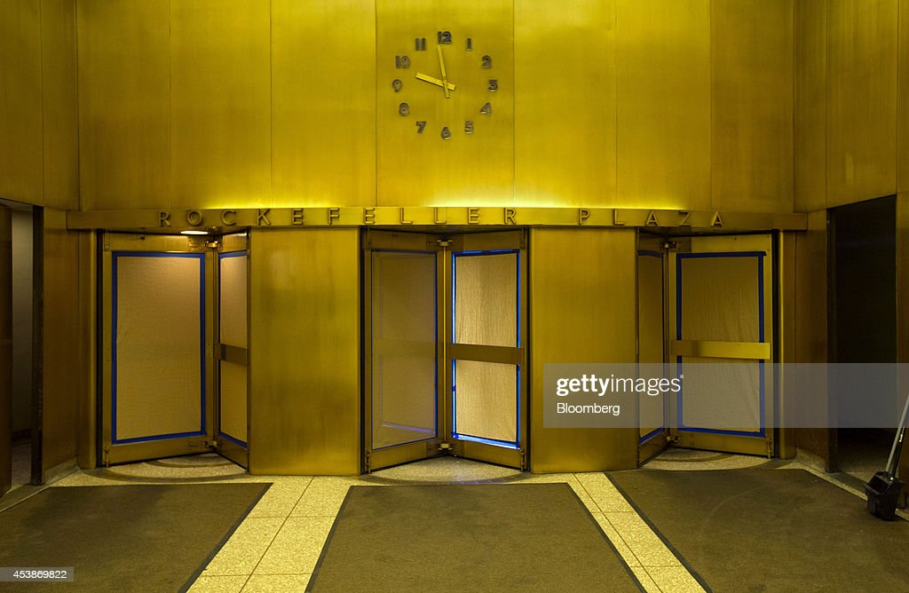 A clock sits above the entrance in the lobby of 75 Rockefeller Plaza in New York, U.S., on Monday, Aug. 18, 2014. New landlord RXR Realty Corp. is upgrading the entire 630,000 square feet. The $150 million project includes raising office ceilings from 7.5 feet (2.3 meters) to 9 feet, and relocating mechanical equipment from the top floor to create new high-priced space, said Scott Rechler, RXRís chief executive officer. Photographer: Jin Lee/Bloomberg via Getty Images