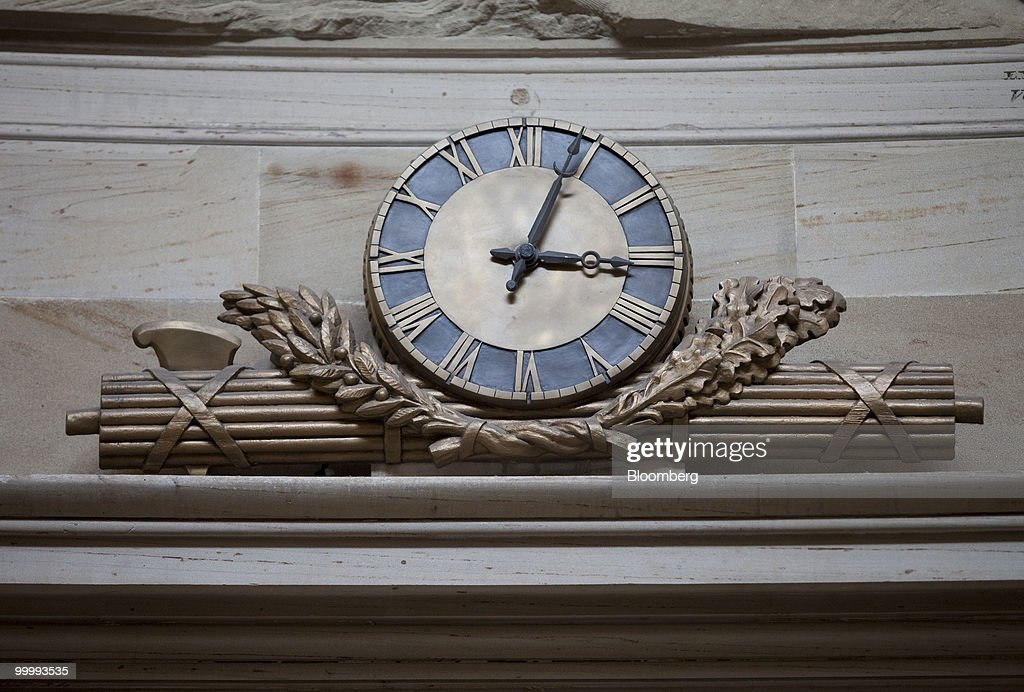 A clock sits in the Capitol building rotunda in Washington, D.C., U.S., on Monday, May 17, 2010. The Capitol is the meeting place for the Senate and House of Representatives. Photographer: Andrew Harrer/Bloomberg via Getty Images
