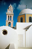 Clock tower beside a Church, Fira, Santorini, Greece