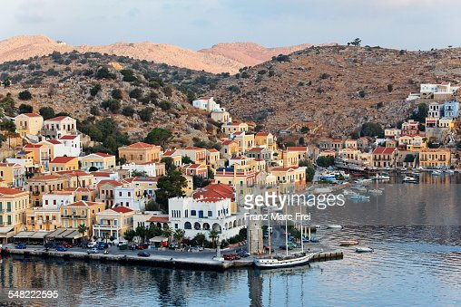 Clock tower, harbour entrance of Yialos, Symi