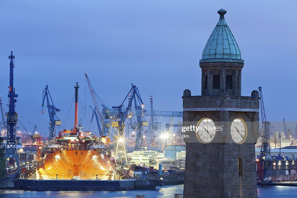 Clock Tower of Elbtunnel and Shipyard at Dusk, Hamburg Harbor