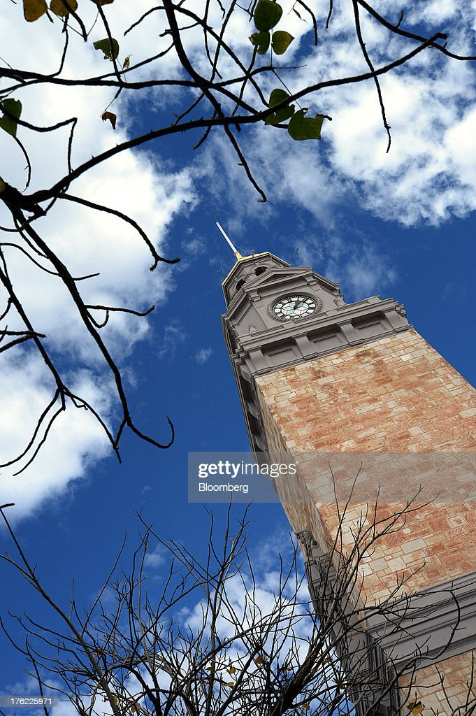 A clock tower stands in the mining town of Kalgoorlie, Australia, on Thursday, Aug. 8, 2013. Western Australia, the nation's largest state by area with 2.6 million square kilometers (1 million square miles) of land, earned A$97 billion from minerals and energy sales in 2012, down from A$108 billion in 2011, according to government figures. Photographer: Carla Gottgens/Bloomberg via Getty Images