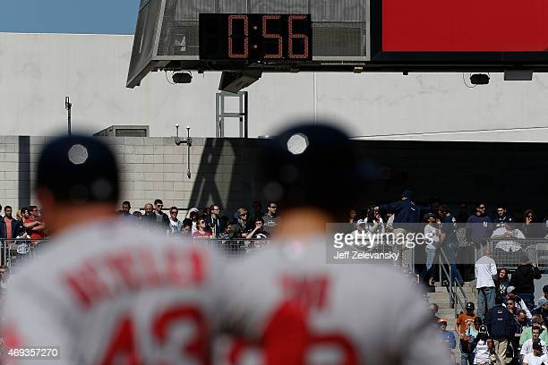 A clock used to time pitching changes runs in left field as the Boston Red Sox face the New York Yankees at Yankee Stadium on April 11 2015 in the...