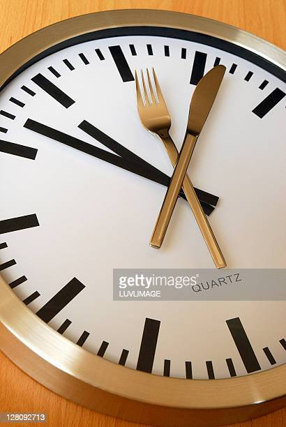 Clock with a fork and knife added