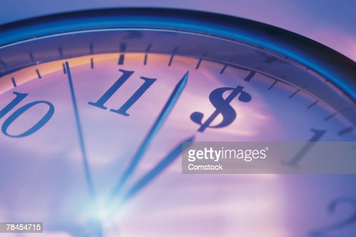 Clock with dollar sign in twelve o'clock position