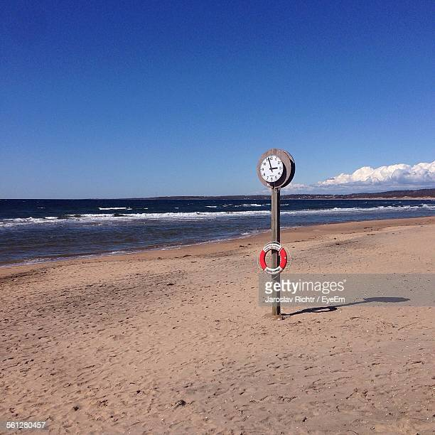 Clock With Lift Belt On Beach