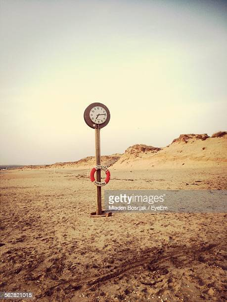 Clock With Safety Belt On Sandy Coast