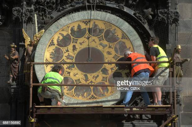 Clockmaker Petr Skala removes the calendar dial of Prague's medieval astronomical clock during the ongoing renovation of the Old Town Hall at the Old...