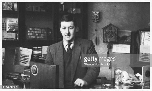 Clockmender, horologist in his shop : Bildbanksbilder