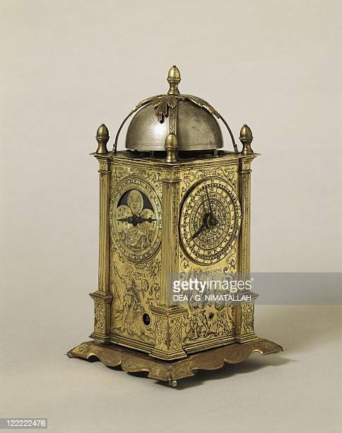 Clocks and Watches 16th century Germany Table clock Case of gilt metal Has calendar and alarm