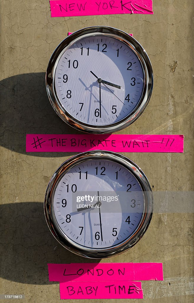 Clocks featuring today's new twitter hashtag '#thebigkatewait' are pictured outside the Lindo Wing of St Mary's Hospital in London, on July 17, 2013, where Prince William and his wife Catherine's baby is expected to be born. Britain's Prince Charles joked Monday that his son Prince William's baby was 'hopefully' on the way, but wife Camilla went further, saying it could arrive 'by the end of the week'.