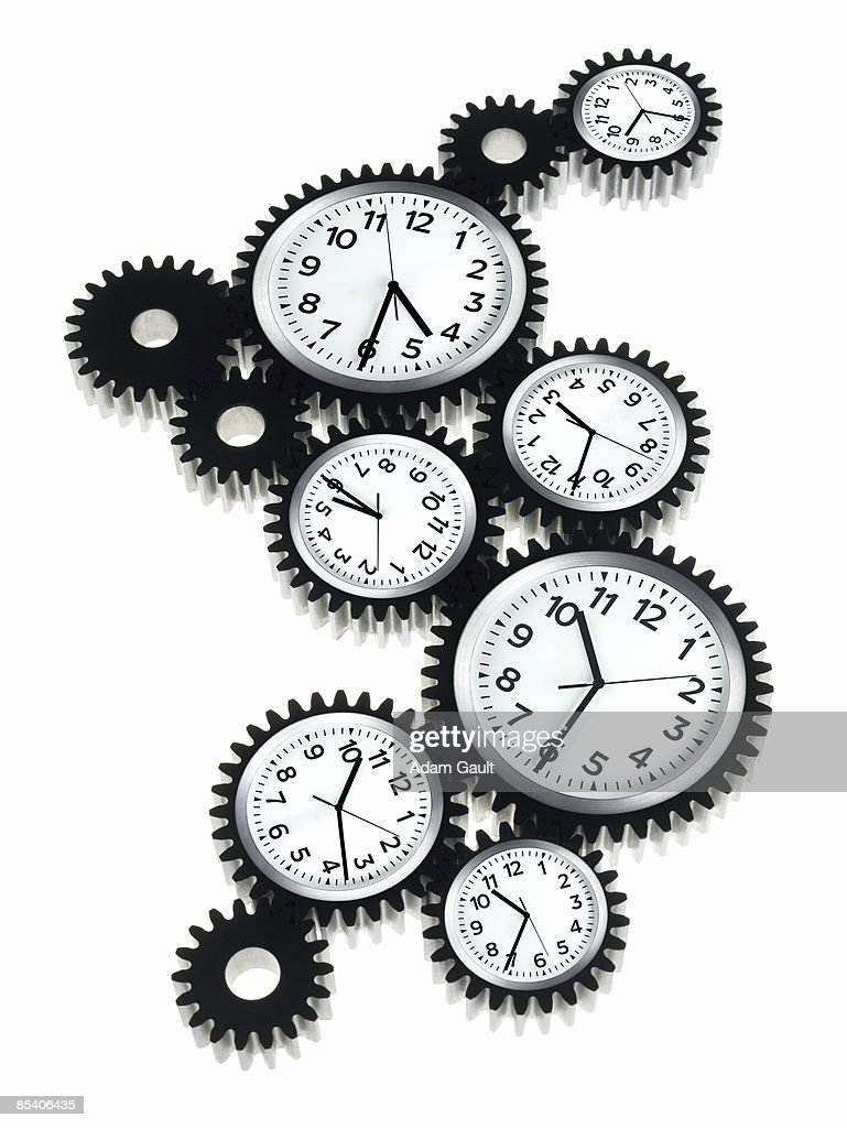 Clocks shaped like cogs : Stock Photo